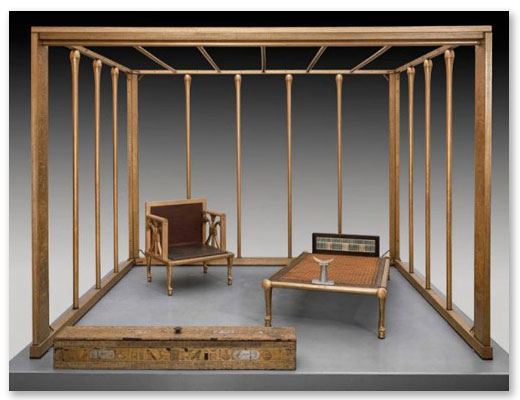 "Above, a full-scale reconstruction (the original was gold plated wood) of the bed canopy and furnishings of Queen Hetepheres, 2500 BCE. Archeological fragments suggest the canopy was hung with linen drapery stored in the ""curtain box,"" foreground. Linen draperies protected royal sleepers from insects and provided privacy. The first ""room-within-a-room?"""
